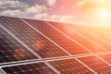 Sun shining on set of solar panels